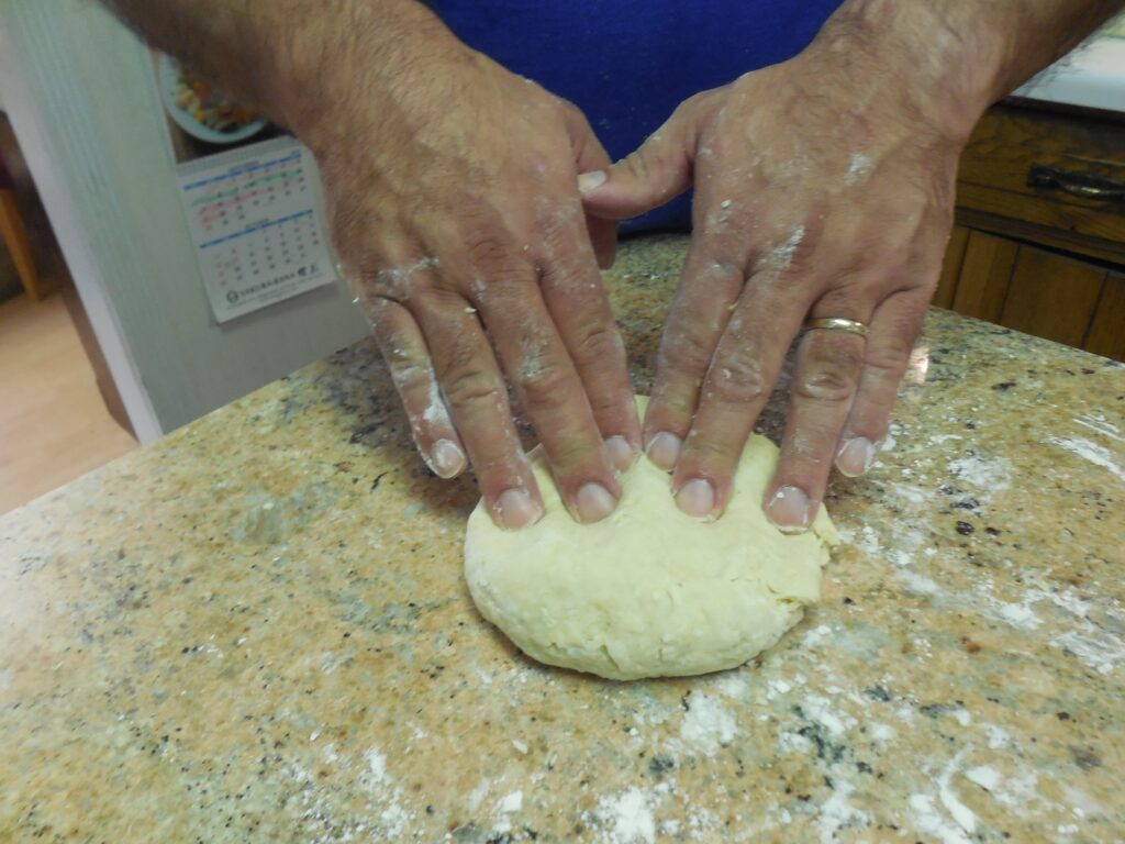 Kneading pasta dough by hand.
